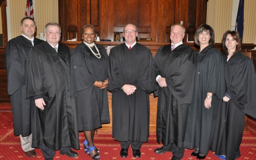 Delaware County Court of Common Pleas President Judge Chad F. Kenney (center) administered the Oath of Office on Jan. 7 to the following magisterial district judges, from left, Gregory J. Loftus, Leonard V. Tenaglia, Dawn L. Vann, Judge Kenney, Walter A. Strohl, Kelly A. Micozzie-Aguirre and Deborah A. Krull.